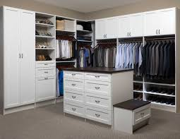 large walk in closet design with white shaker cabinets