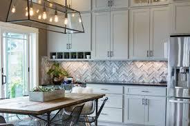 ... Reclaimed White Herringbone Barnwood Backsplash on a Fort Collins  Residence in an upscale chic modern kitchen ...