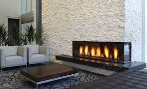 three story natural stacked stone veneer fireplace in norstone white quartz rock panels in edmonton