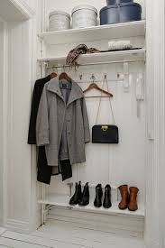Hallway hanging storage / shelving for outerwear.