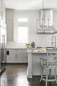 light gray kitchen with all white subway tiles