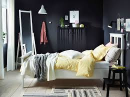 Bedroom with Scandinavian beauty with smart BREIM wardrobe View in gallery  NYPONROS bed frame stands in contrast to the dark backdrop and sideboard