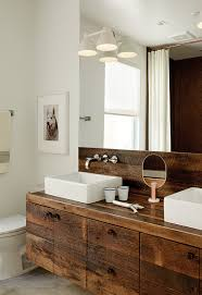 dwell bathroom cabinet: builder luke gilligan of gilligan development used reclaimed oak planks from a deconstructed barn to create