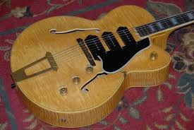 gibson es5 try to at least play a vintage es 5 before you make a decision i think you will agree that the extra cost is well worth it