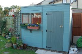 wooden shed in blue paint