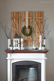 view in gallery diy barn wood shutters over a fireplace mantel