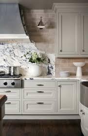 marble slab and subway tile backsplash with light grey kitchen cabinets kitchen backsplash ideas 2016