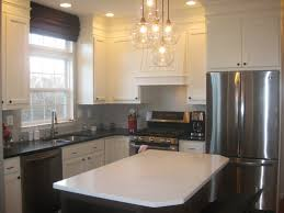 stylish l shaped white diy kitchen cabinets with black countertop