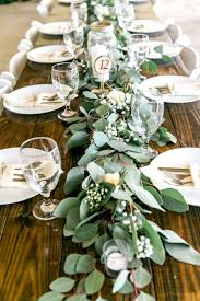 Long Feasting Table With Garland Greenery Centerpieces And Wooden