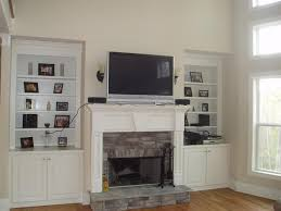 fireplace country style bedroom remodel mounting plasma tv over fireplace brick stone surround copper indoor wall