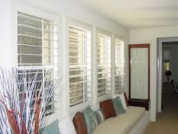 cost of shutters. Window Shutter In White Color A Long Bench Under The Windows With Light Cream Mattress And Cost Of Shutters HomesFeed