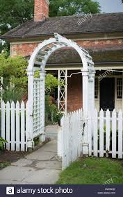 picket fence gate with arbor. Traditional White Pickett Fence And Arbor Gateway To The Garden Of A Farm House In Ontario Canada Picket Gate With