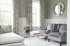 stirling mills interior design white wainscoting lined with gray grasscloth wallpaper frames windows dressed in ivory and blue curtains in an elegant gray