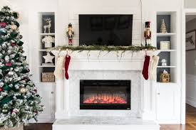 diy fireplace makeover tiling over brick fireplace before and after