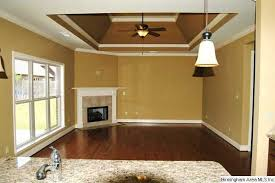 Elegant dark wood floor dining room photo in Salt Lake City with beige  walls  vaulted ceiling master bedroom beam ...