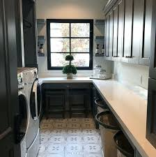 black and white quartz countertops laundry room with charcoal gray cabinets window dark coun