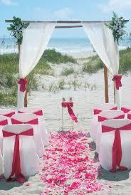 Beach wedding setup with fuchsia sashes/petals.  www.CentralFloridaWeddingGroup.com | Beach Ceremony Setups | Pinterest |  Beach wedding setup, Beach weddings ...