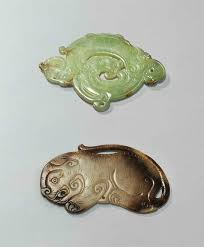 a grey and russet jade tiger pendant