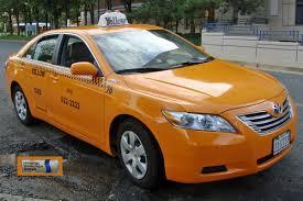 File:Toyota Camry hybrid DCA 07 2009 Taxi VA 6400.jpg - Wikimedia ...