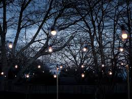 hang outdoor string lights from diy posts how to cheery