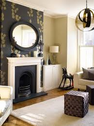 style tip make your fireplace a really attention grabber by surrounding it with a feature wall
