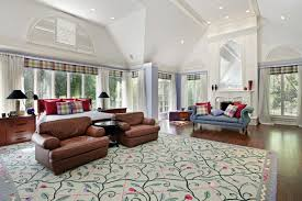 big master bedrooms couch bedroom fireplace:  simple large bedroom design floral pattern carpet floor blue sectional couches black gateleg coffee