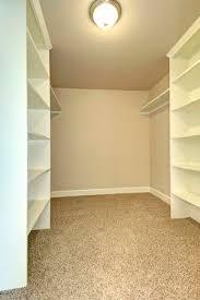 empty walk in closet. Bright Empty Walk-in Closet With Wood Shelves, Beige Carpet Floor. Stock  Photo Walk In Y
