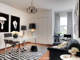 Contemporary Home Office With Laminate Floors, Chandelier, World Market  Black And White Striped Dhurrie