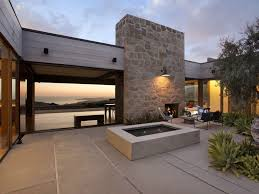 modern design outdoor furniture decorate. outdoor area decorated with furniture and stone fireplace design combined modern lighting decorate o