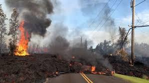 lava from a fissure slowly advances to the northeast on hookapu street after the eruption of hawaii s kilauea volcano near pahoa hawaii on may 5