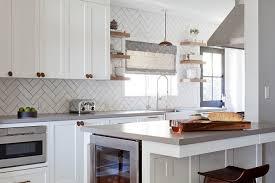 white herringbone kitchen backsplash tiles with gray grout