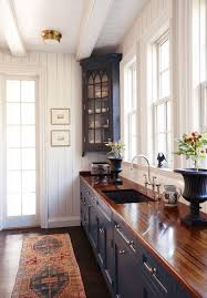 should you decorate above kitchen cabinets how to decorate top of