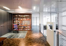 millennium tower loft home office example of a trendy home office design in seattle with dark blueprints office desk preview save