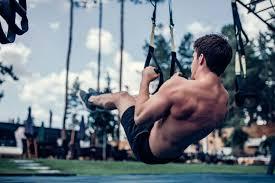 man outdoor on trx suspension trainer
