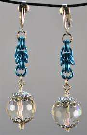 baby blue chandelier earrings with blue chain mail and faceted glass drop beads