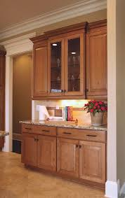 lighting cabinets. Maple Raised Panel Wall Cabinets With Glass Doors And Stepped Light Rail Crown Molding Lighting