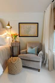 A cozy club chair adds warmth to a master bedroom. Chair on one side and  small table. or rocking chair for mom. Ill cover my old queen and use it my  master ...