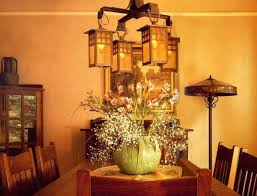 dining room with wooden furniture and mission style chandelier