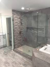 frameless glass shower enclosure notched over bench