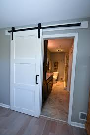 we added a sliding white barn door with wrought iron trim