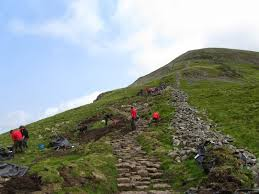team news for  a work party fix the fells lengthsmen last summer on a path project up fairfield a lovely day