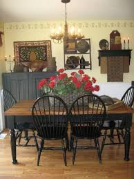 a lovely dining room filled with period 18 19th century american antiques the red flowers on the table adds the perfect color to an otherwise warm room