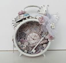 view in gallery white vintage alarm clock with paper flowers and key inside