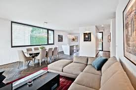 apartment attractive modern apartment living room with gray smooth rug and cream sofa also oval