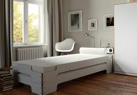 A modern solution for small spaces dates back to 1966 when German designer  Rolf Heide created his stackable daybed. The simple wooden bed frames pile  neatly ...