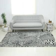 hand tufted wool area rug wild harmony zebra and leopard black
