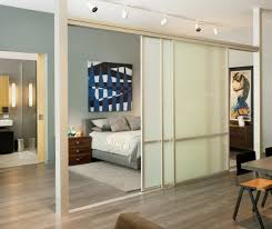 View in gallery Spacious loft bedroom with sleek and delicate sliding doors