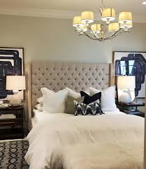 Beige Tufted Wingback Bed with Tiered Nightstands Transitional