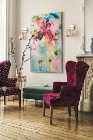 a couple of very bold and colorful upholstered wingback chairs and a bold artwork make the