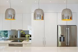 kitchen bench lighting. Metallic Pendant Lights Hung In A Row Over The Kitchen Bench Lighting C